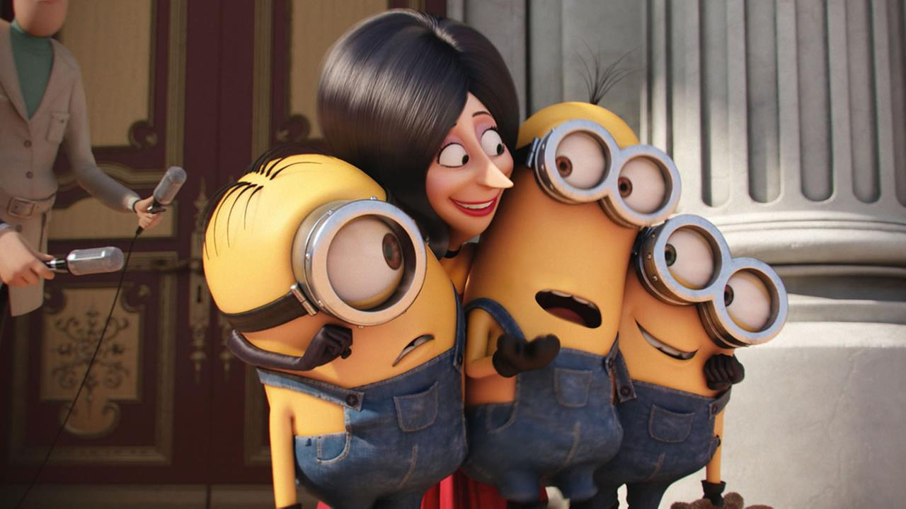 In this image released by Universal Pictures, Scarlet Overkill, voiced by Sandra Bullock appears with minions in a scene from the animated feature, Minions. (Illumination Entertainment/Universal Pictures via AP)
