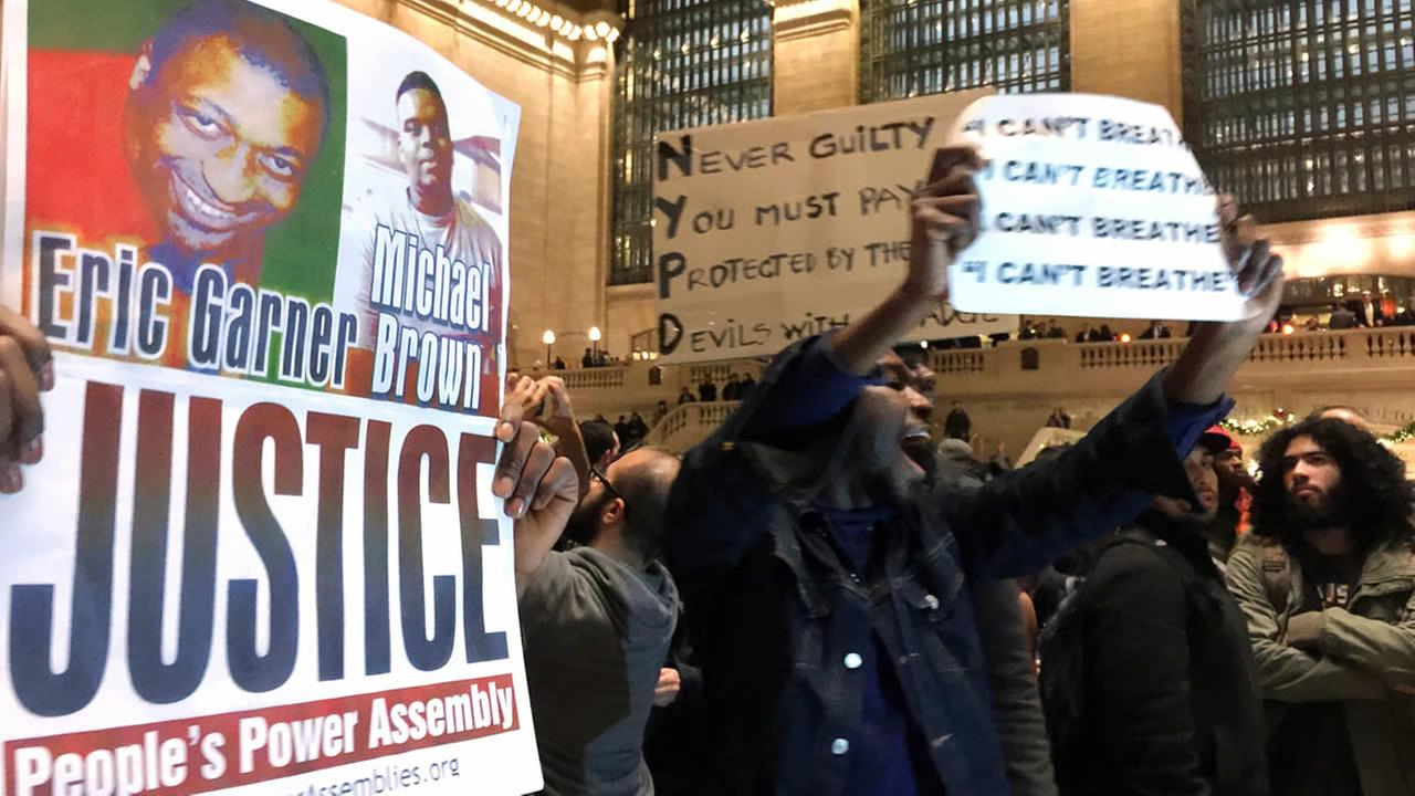 In this Dec. 3, 2014, photo, people gather in New Yorks Grand Central Terminal to protest the death of Eric Garner. (AP Photo/Jaime Holguin, File)