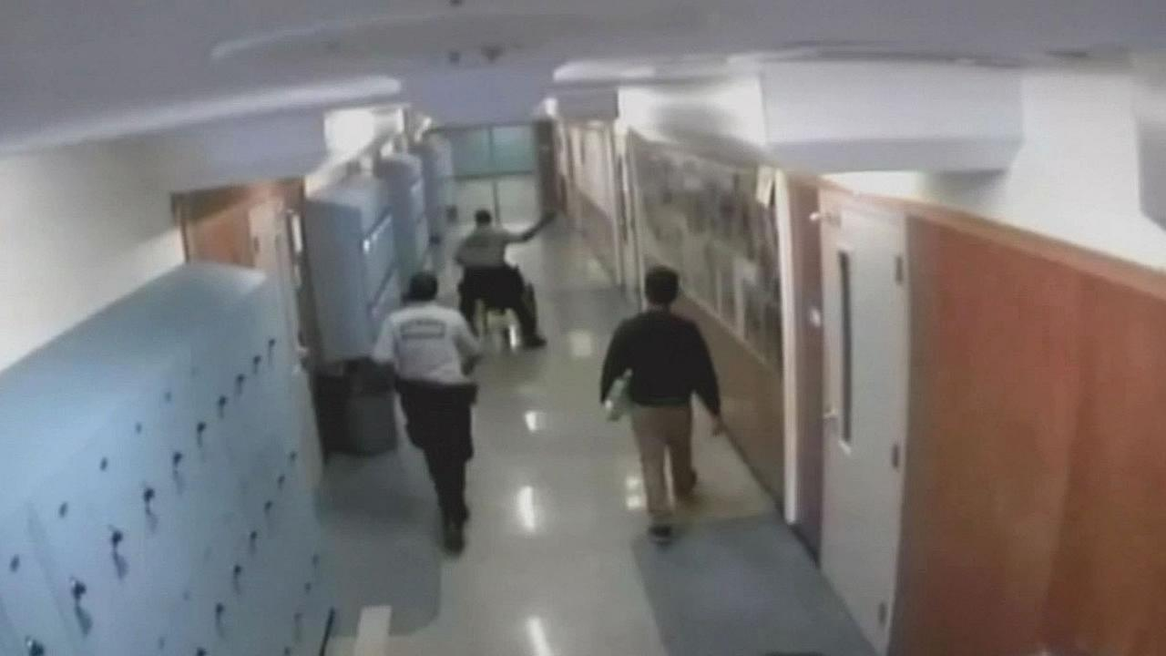 security officer beating student in wheelchair at Oakland High School
