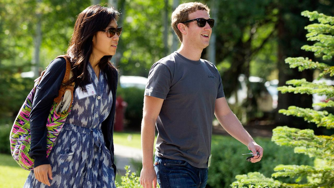 FILE -- Mark Zuckerberg, right, president and CEO of Facebook, walks with his wife Priscilla Chan. (AP Photo/Julie Jacobson)