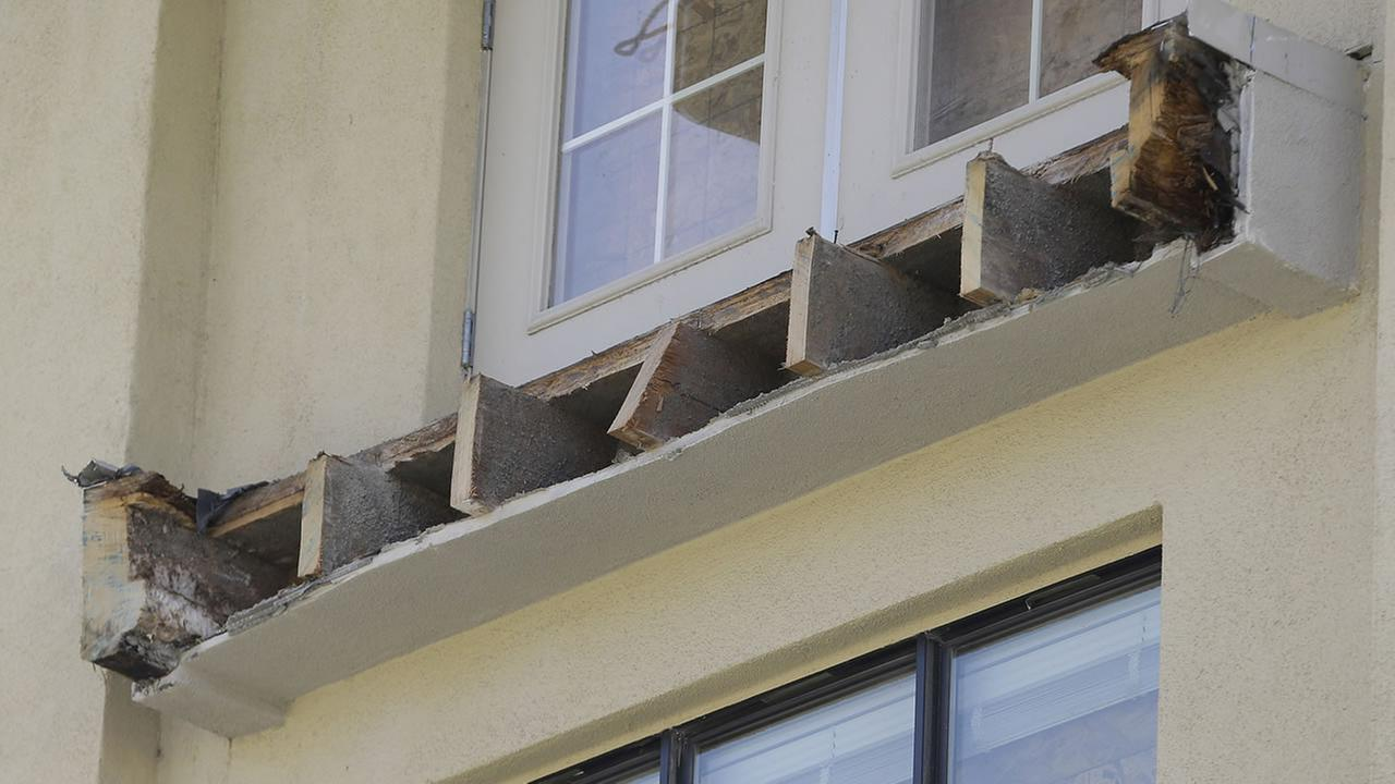 The remaining wood beams of an apartment building balcony that was removed below a balcony that collapsed is shown is shown in Berkeley, Calif., Thursday, June 18, 2015. (AP Photo)