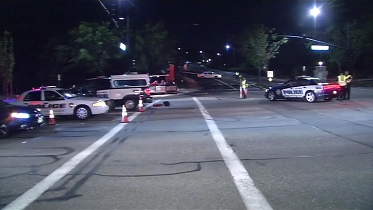 Police investigating the scene where a pedestrian was struck and killed Wednesday night, July 15, 2015,  in San Ramon, Calif.