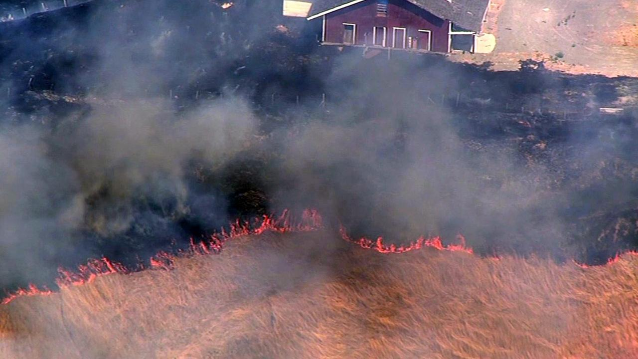 Grass fire threatening homes in Alameda County, Monday, July 20, 2015.KGO-TV