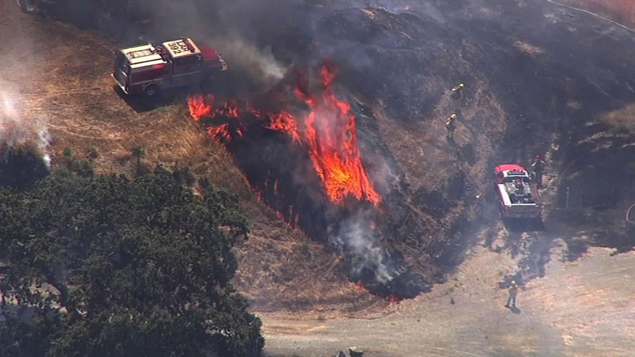 A grass fire burned along I-680 in Sunol on Monday, July 20, 2015 KGO-TV