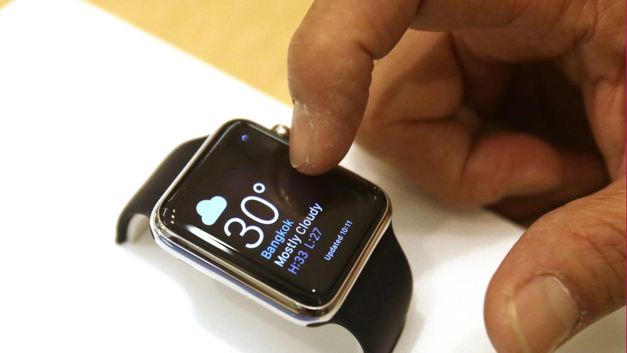 A customer demonstrates an Apple Watch at an Apple Store in Bangkok as Apple Watch made its debut in Thailand Friday, July 17, 2015.