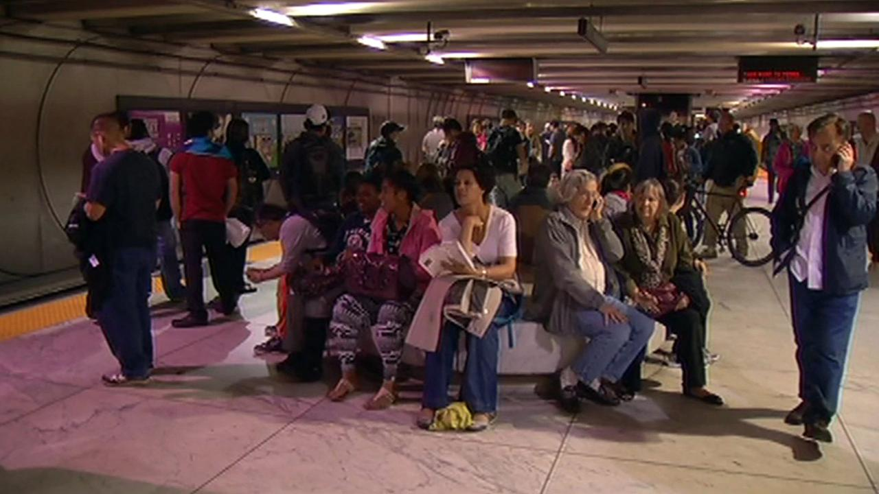 Commuters wait for BART to reopen after fatality on the tracks.
