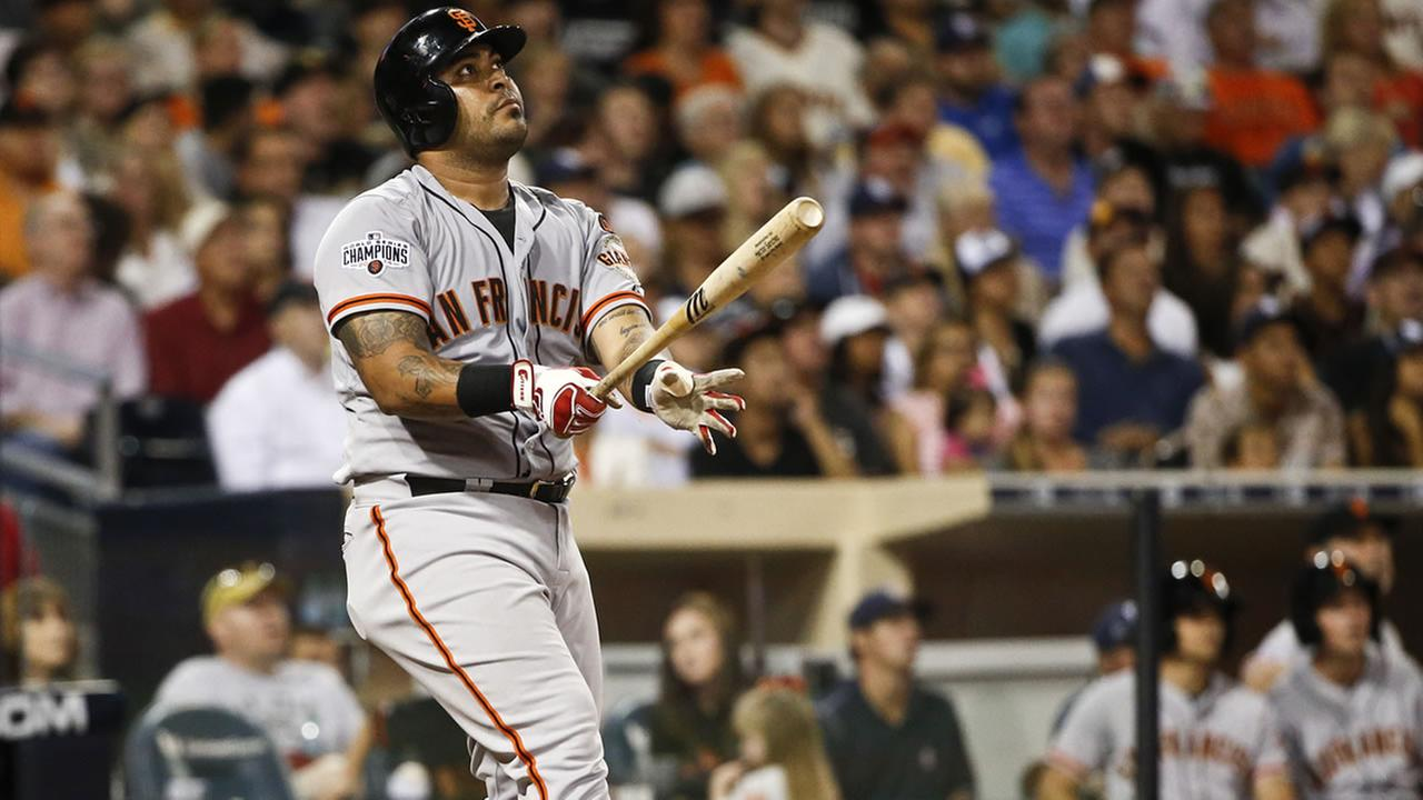San Francisco Giants Hector Sanchez watches the flight of his grand slam home run