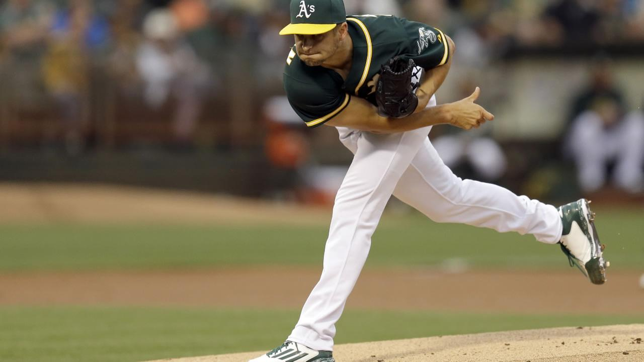 Oakland Athletics pitcher Kendall Graveman works against the Toronto Blue Jays in the first inning of a baseball game Tuesday, July 21, 2015, in Oakland, Calif.