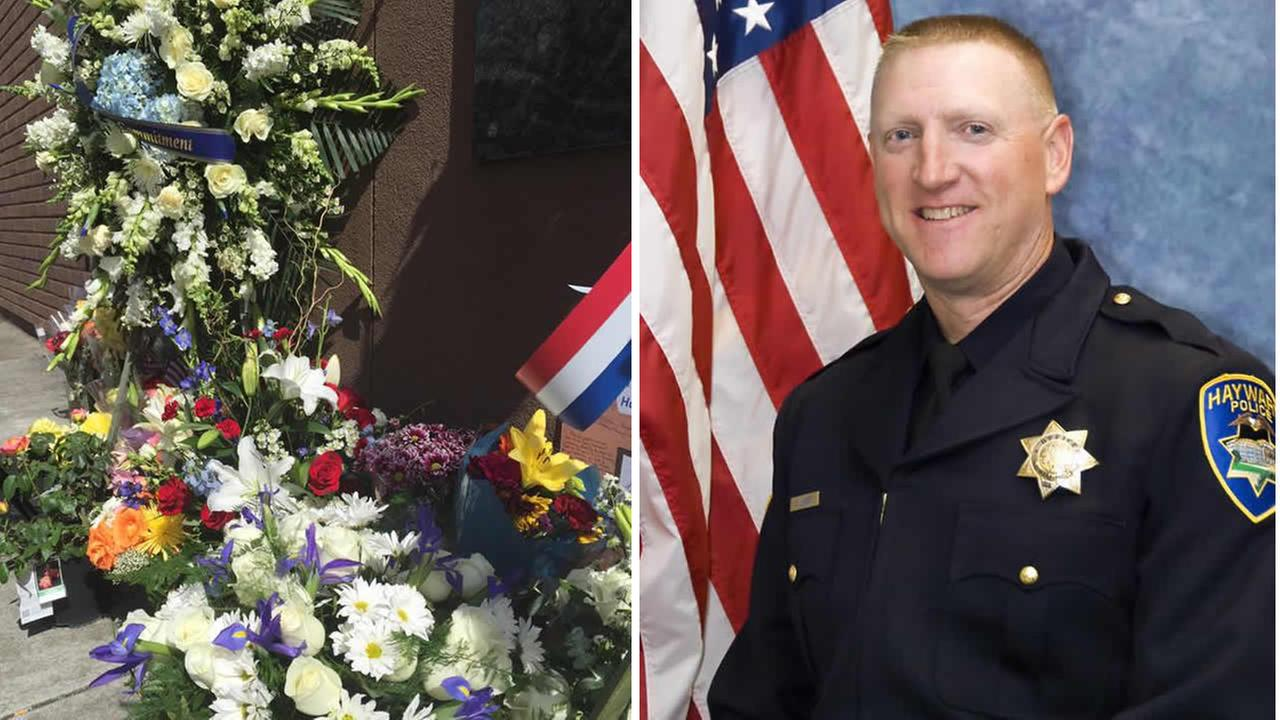 Community members left candles and flowers to honor Hayward police Sgt. Scott Lunger, who was shot and killed during a traffic stop in Hayward, Calif. on July 22, 2015.