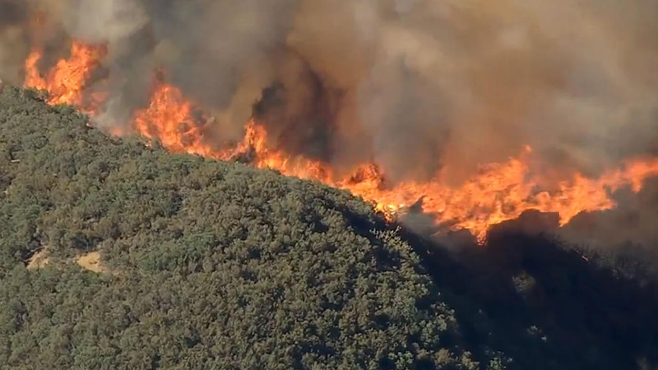 A large fire burning south of Lake Berryessa is threatening structures and closing roads in the area, July 22, 2015. KGO-TV