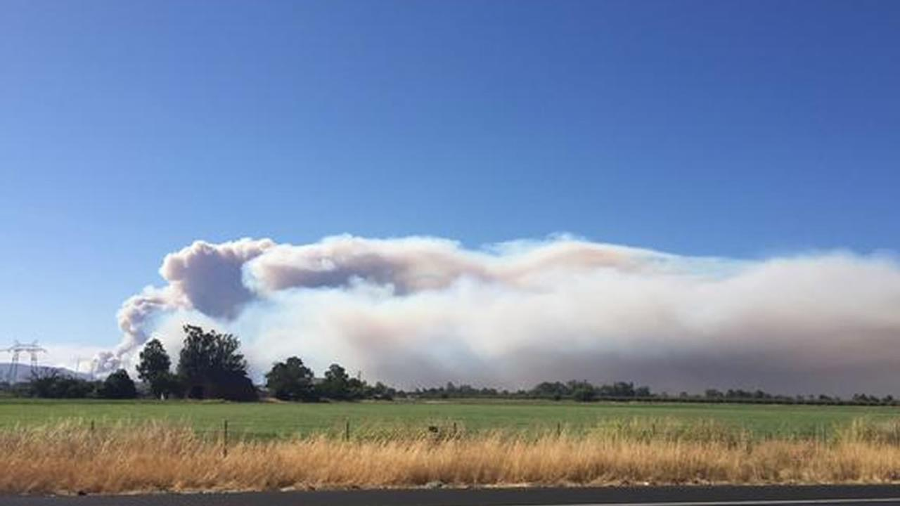 A large fire burning south of Lake Berryessa is threatening structures and closing roads in the area, July 22, 2015. Alicia Fremling/Twitter