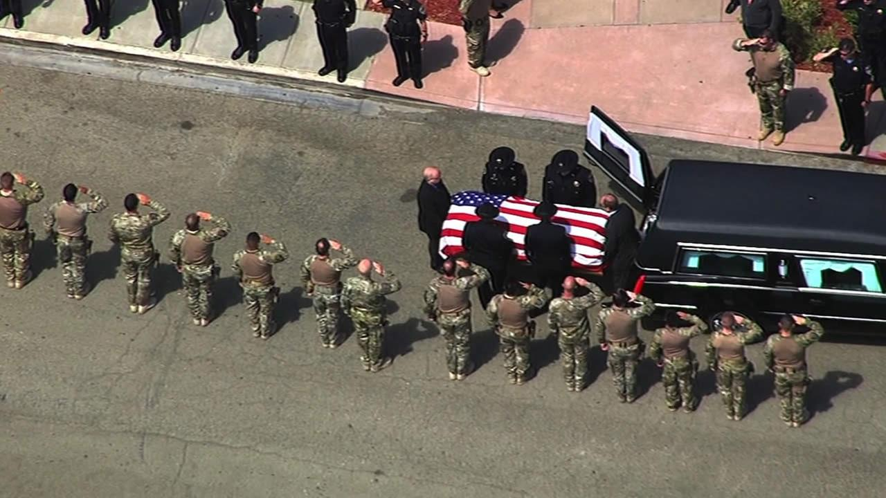 Hayward police carry the casket of slain Sgt. Scott Lunger to Chapel of the Chimes on Thursday, July 23, 2015.