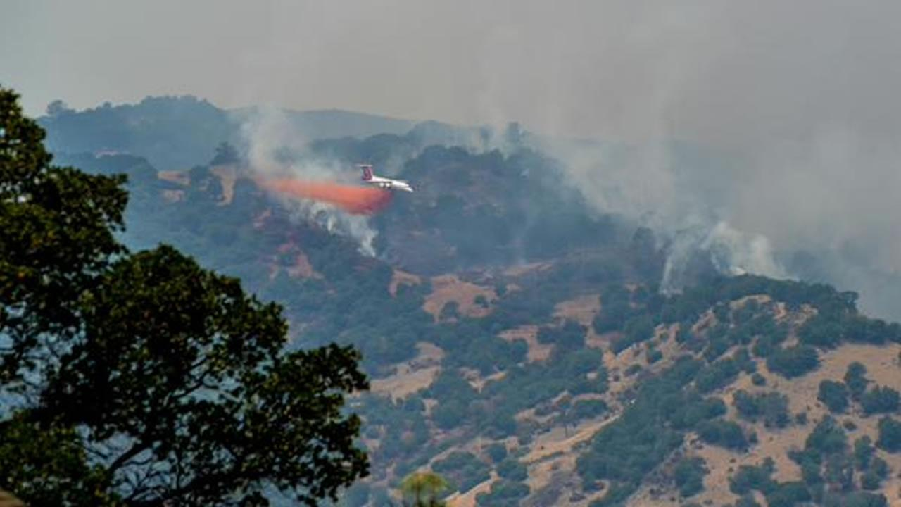 A large fire burning south of Lake Berryessa is threatening structures, forcing evacuations and closing roads in the area, July 23, 2015. KGO-TV