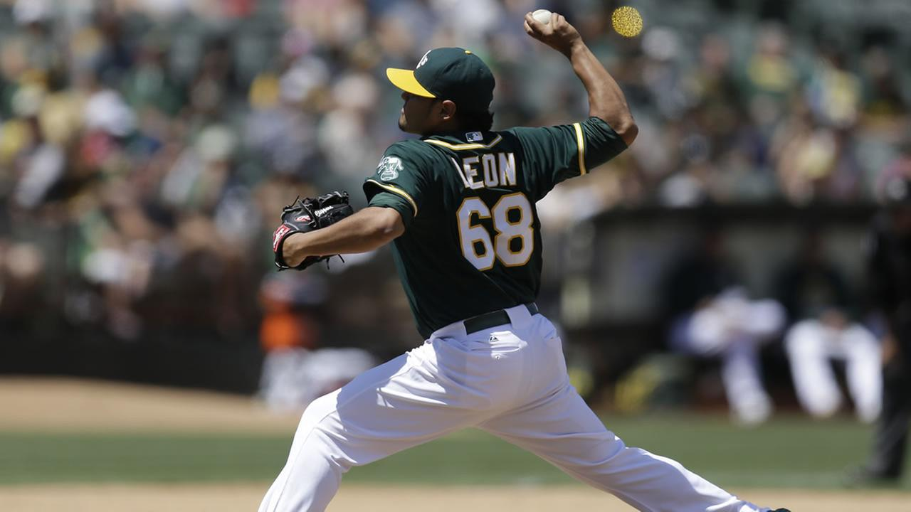 Oakland Athletics pitcher Arnold Leon works against the Toronto Blue Jays in the eighth inning of a baseball game July 23, 2015, in Oakland, Calif. (AP Photo/Ben Margot)