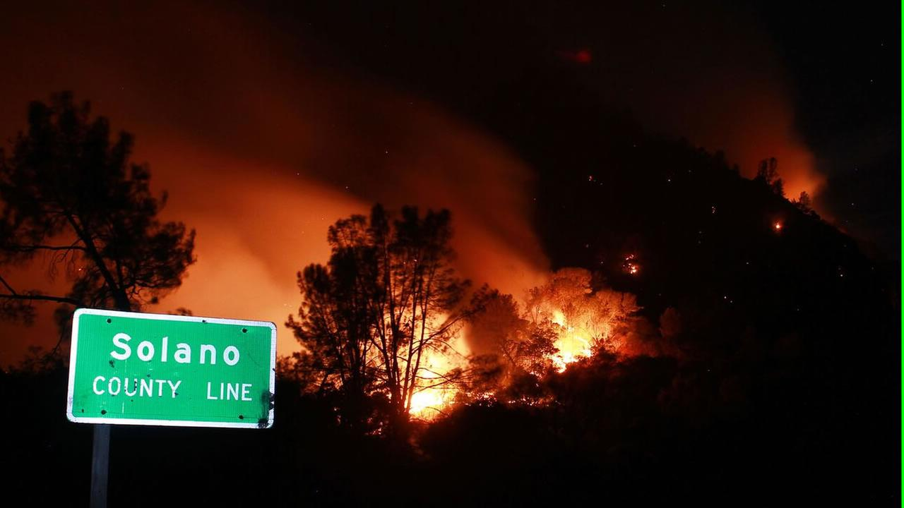 A large fire burning south of Lake Berryessa is threatening structures and closing roads in the area, July 22, 2015. Matthew Henderson/facebook.com/onfirephotos