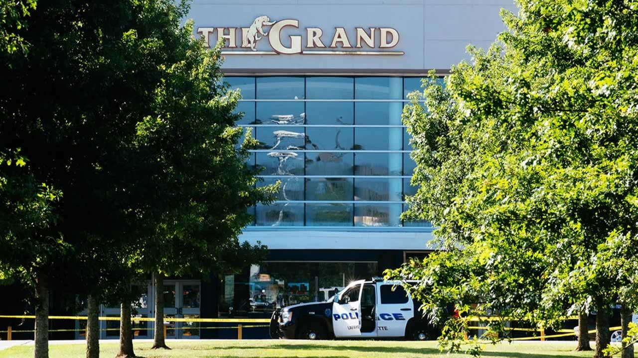 Authorities park at the scene of a Thursday night shooting at The Grand Theatre, in Lafayette, La. on Friday, July 24, 2015.