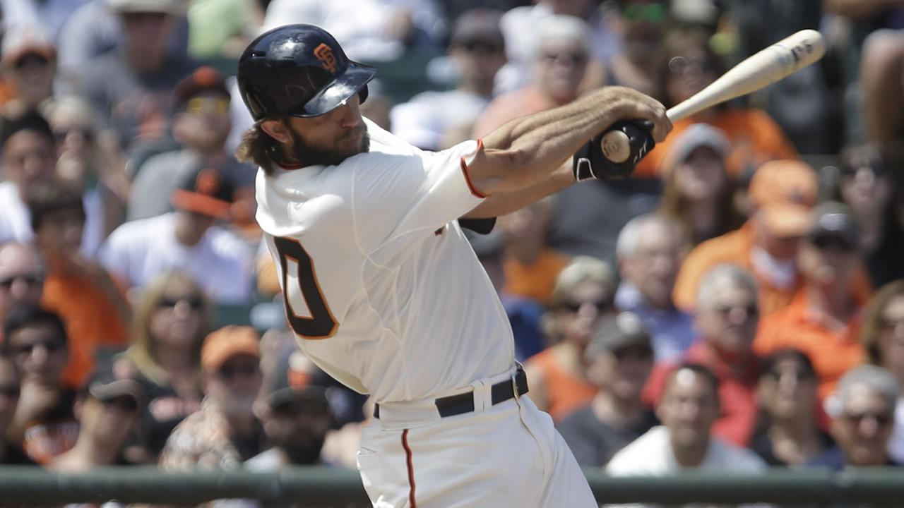 San Francisco Giants pitcher Madison Bumgarner swings against the Oakland Athletics in the sixth inning of a baseball game Saturday, July 25, 2015, in San Francisco.