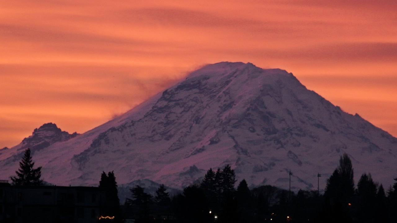 Mount Rainer is seen at dawn in this Jan. 2, 2012, file photo, from Seattle, some 50 miles away from the national park. (AP Photo/Elaine Thompson, File)