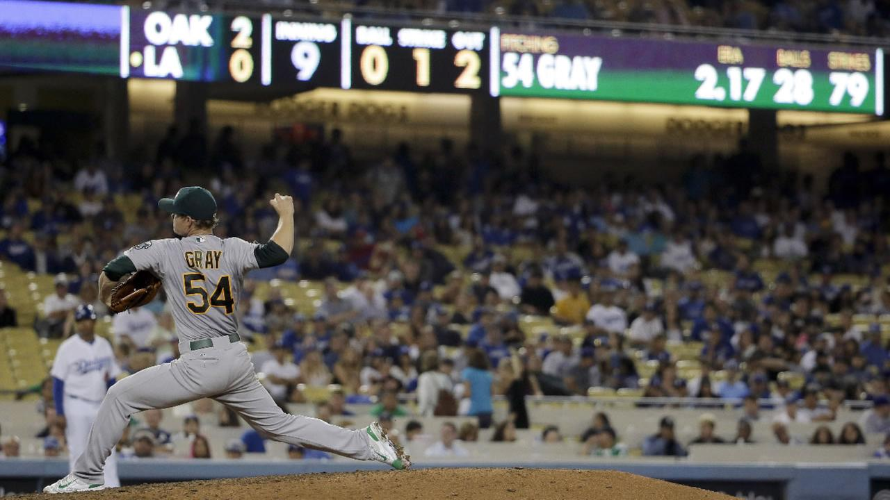 Oakland Athletics starting pitcher Sonny Gray throws against the Los Angeles Dodgers during the ninth inning of a baseball game in Los Angeles, Tuesday, July 28, 2015.