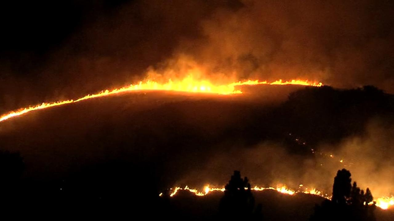 Fire burning on hill near Hwy 24 in Lafayette, Wednesday, July 29, 2015.