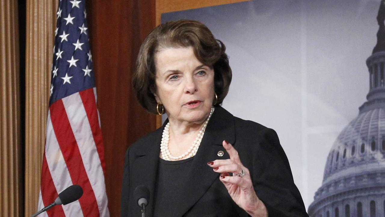 This Dec. 21, 2012 file photo shows Senate intelligence committee chair, Sen. Diane Feinstein, D-Cal., left, speaking at a Capitol Hill news conference in Washington.