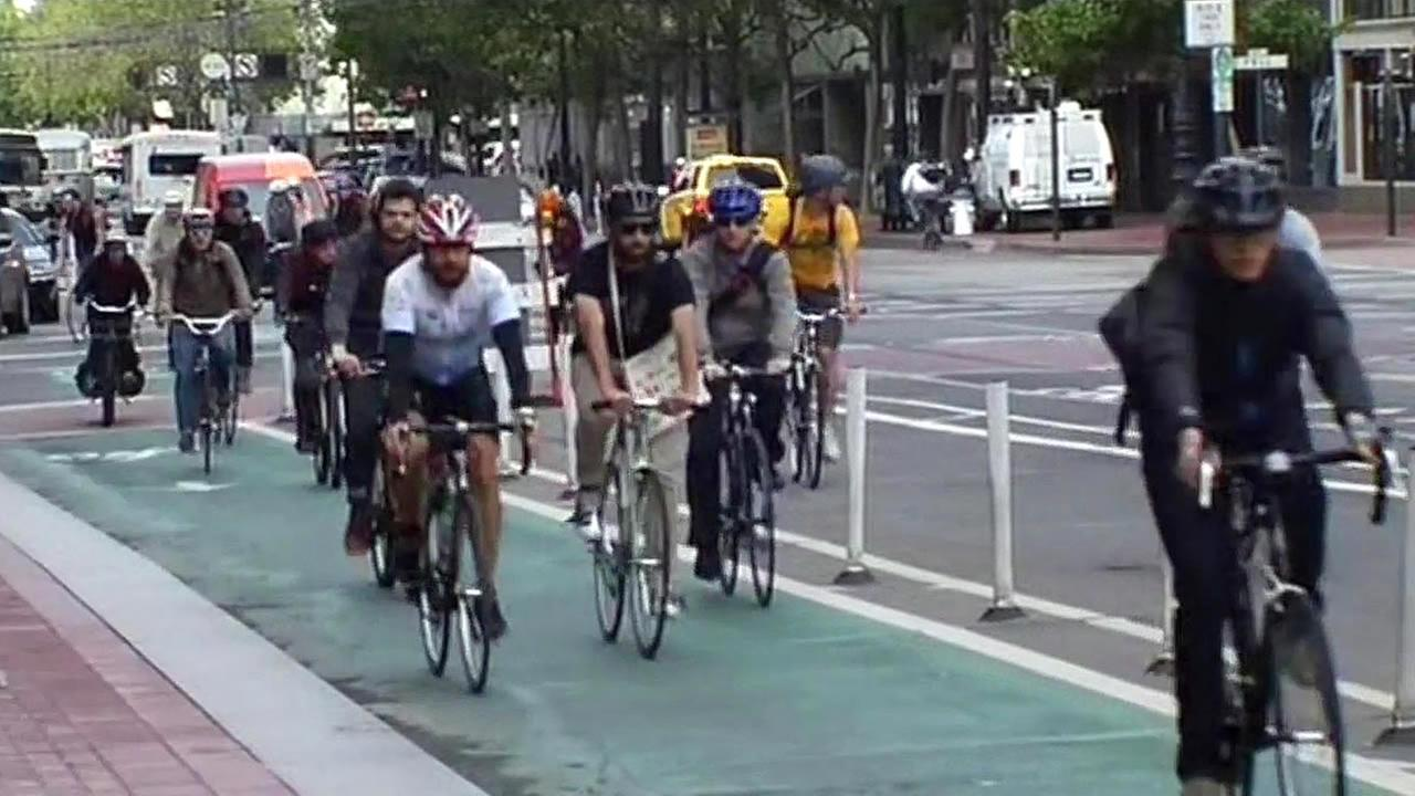 San Francisco bicyclists ride down a bike lane