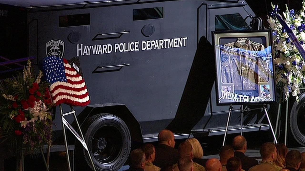 A Hayward police vehicle and one of Sgt. Scott Lungers uniforms at the public memorial at Oracle Arena in Oakland, Calif. on Thursday, July 30, 2015.
