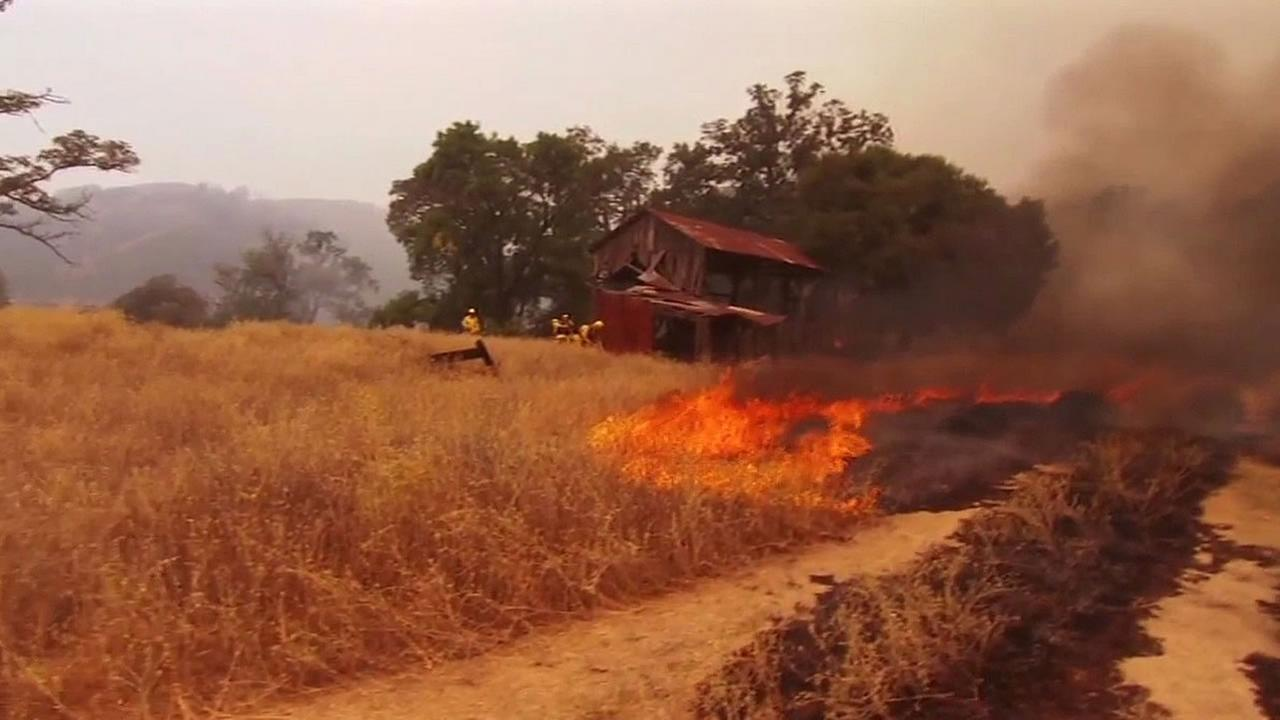 Rocky Fire burns near a barn