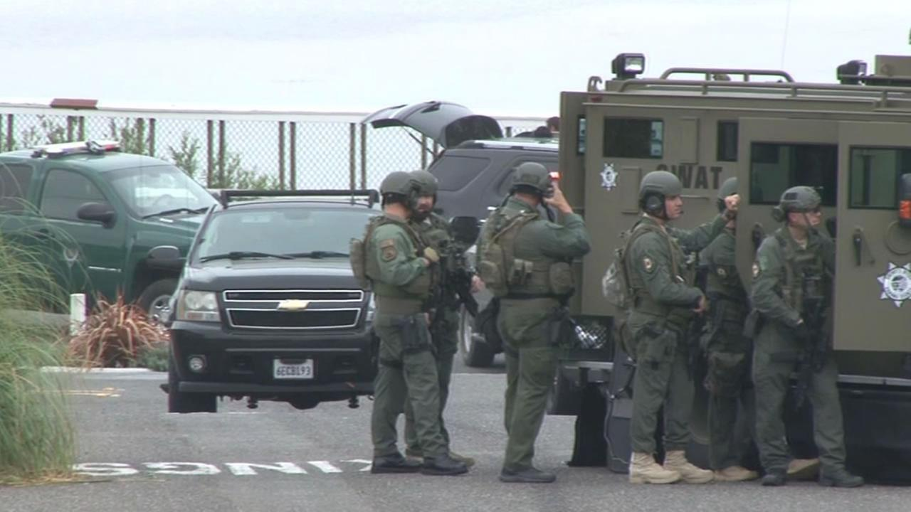 A SWAT team arrives on the scene of a shooting near where Taylor Street meets Highway 1 in Bodega Bay, Calif. on Friday, July 31, 2015.
