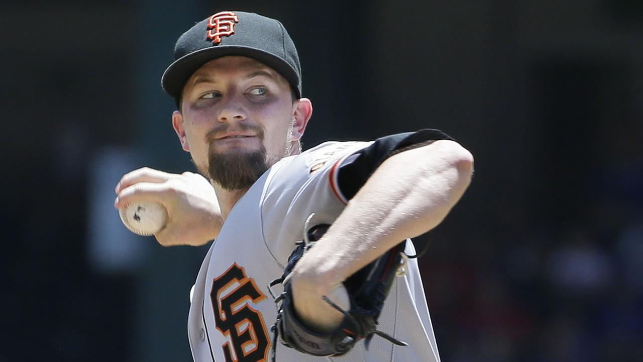 San Francisco Giants starting pitcher Mike Leake throws during the first inning of a baseball game against the Texas Rangers in Arlington, Texas, Aug. 2, 2015. (AP Photo/LM Otero)