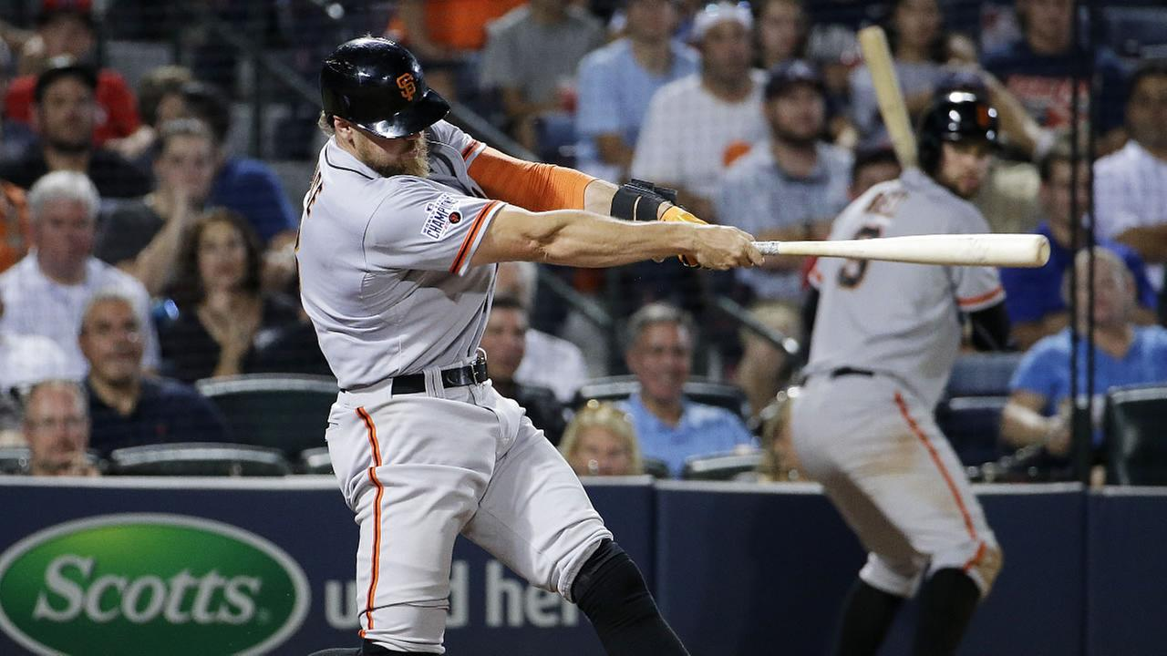 San Francisco Giants Hunter Pence hits a three-run home run in the eighth inning of a baseball game against the Atlanta Braves Tuesday, Aug. 4, 2015, in Atlanta.