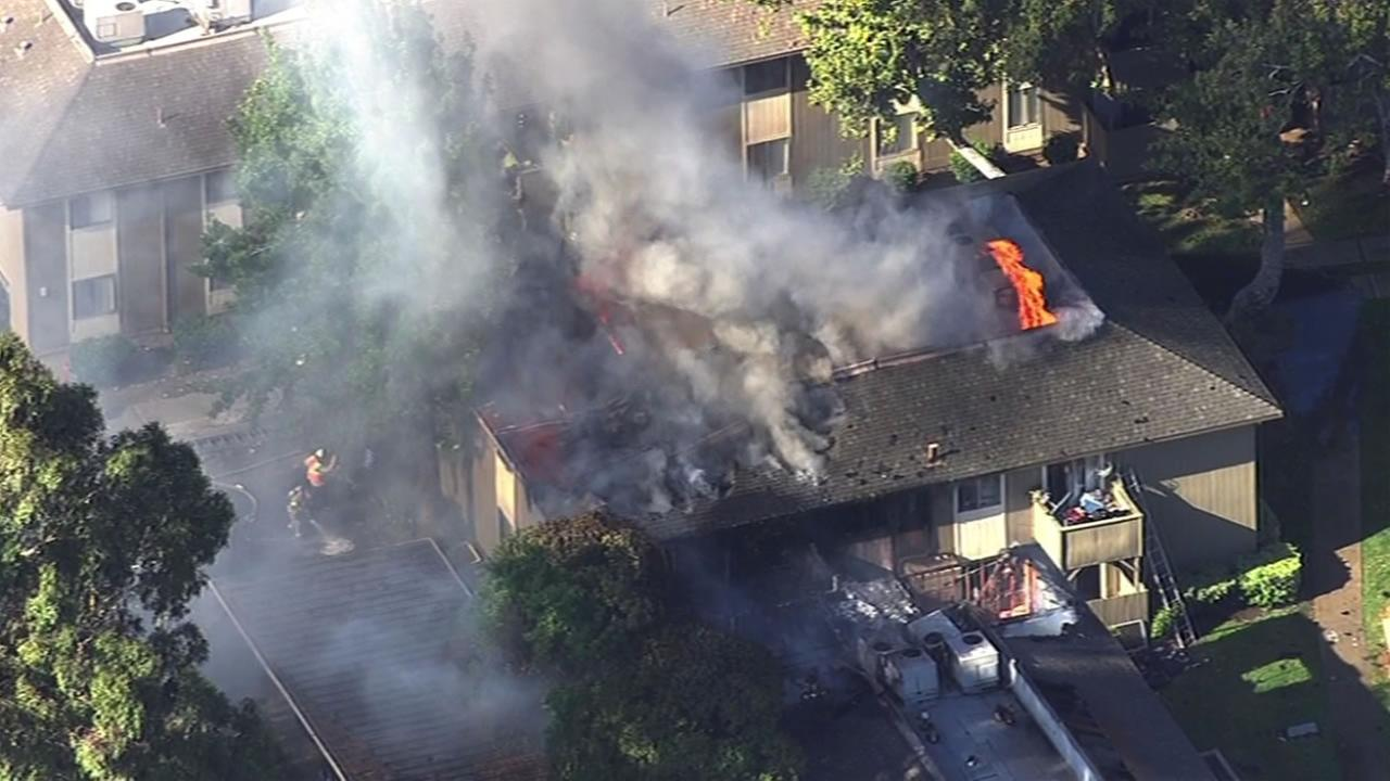 Fire fighters battle a three-alarm fire at an apartment complex in Antioch, Calif. on Wednesday, August 5, 2015.