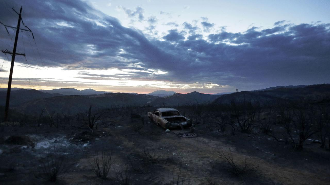 A car burned in the Rocky Fire is shown near Lower Lake, Calif., Tuesday, Aug. 4, 2015.