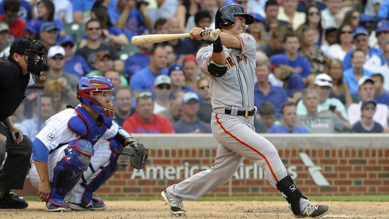 San Francisco Giants Nori Aoki follows through on a home run against the Chicago Cubs during the eighth inning of a baseball game, Friday, Aug. 7, 2015, in Chicago.