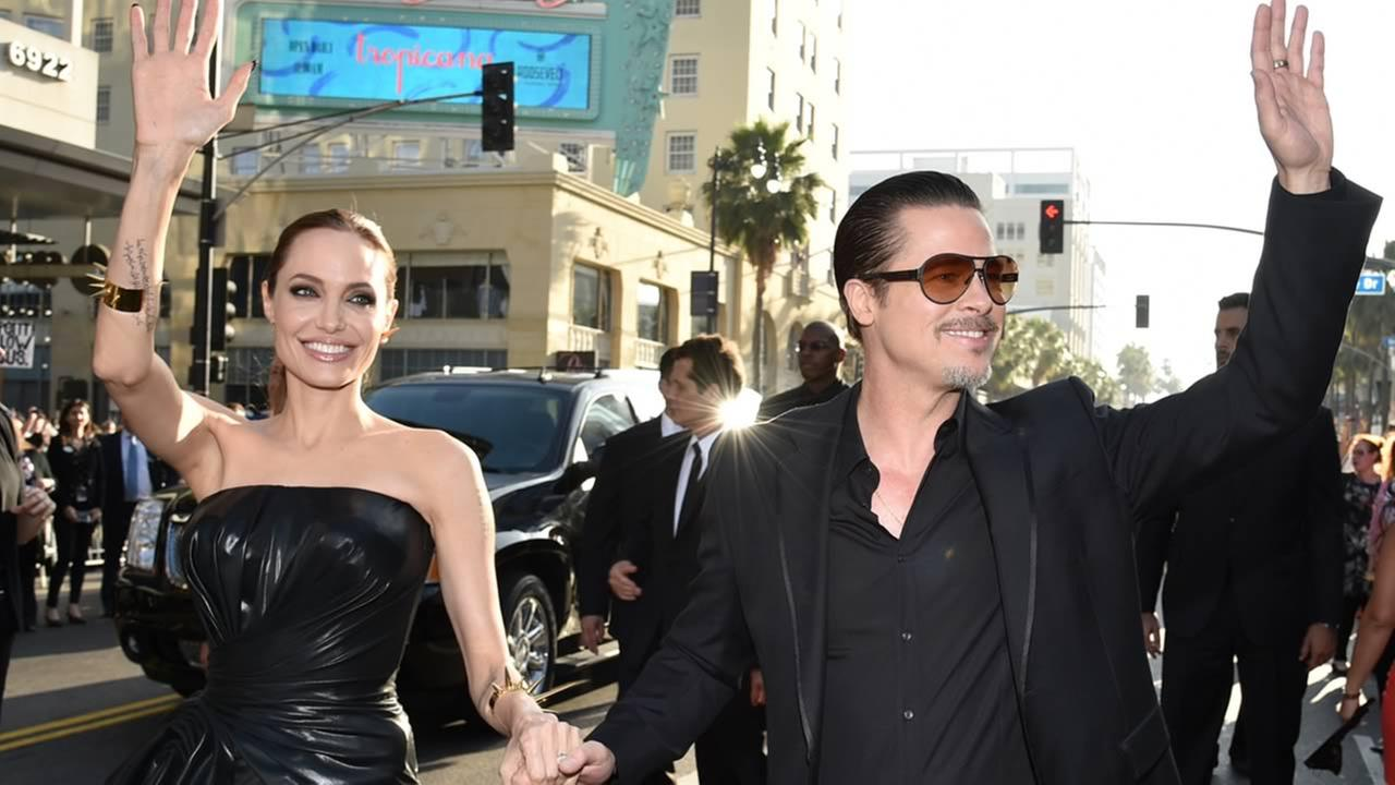 Angelina Jolie, left, and Brad Pitt arrive at the world premiere of Maleficent at the El Capitan Theatre on May 28, 2014, in Los Angeles. (Photo by John Shearer/Invision/AP)