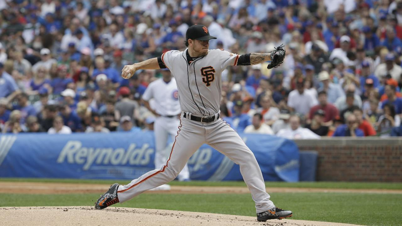San Francisco Giants starter Jake Peavy throws against the Chicago Cubs during the first inning of a baseball game Sunday, Aug. 9, 2015, in Chicago.
