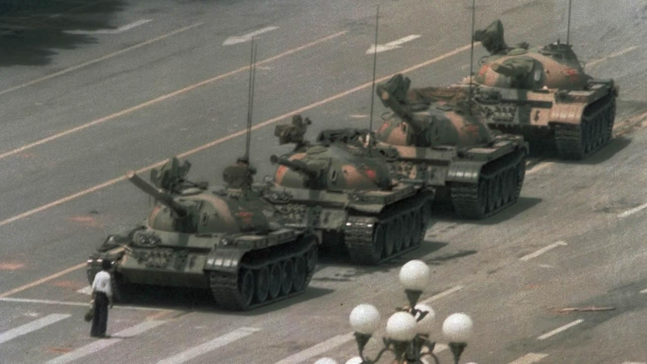 In this June 5, 1989 photo, a Chinese man stands alone to block tanks heading east on Beijings Changan Blvd. from Tiananmen Square in Beijing. (AP Photo/Jeff Widener, File)