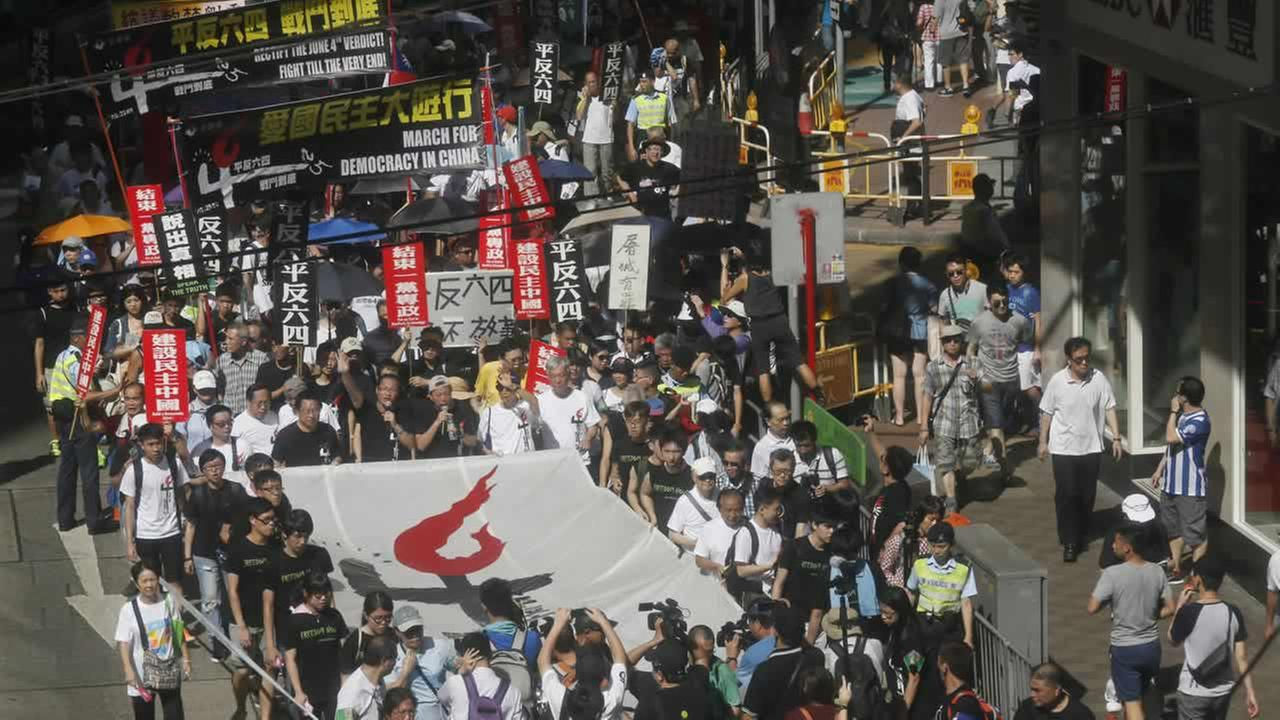 Thousands march in Hong Kong Sunday, June 1, 2014, to mark the 25th anniversary of the bloody crackdown on Tiananmen Square. (AP Photo/Vincent Yu)