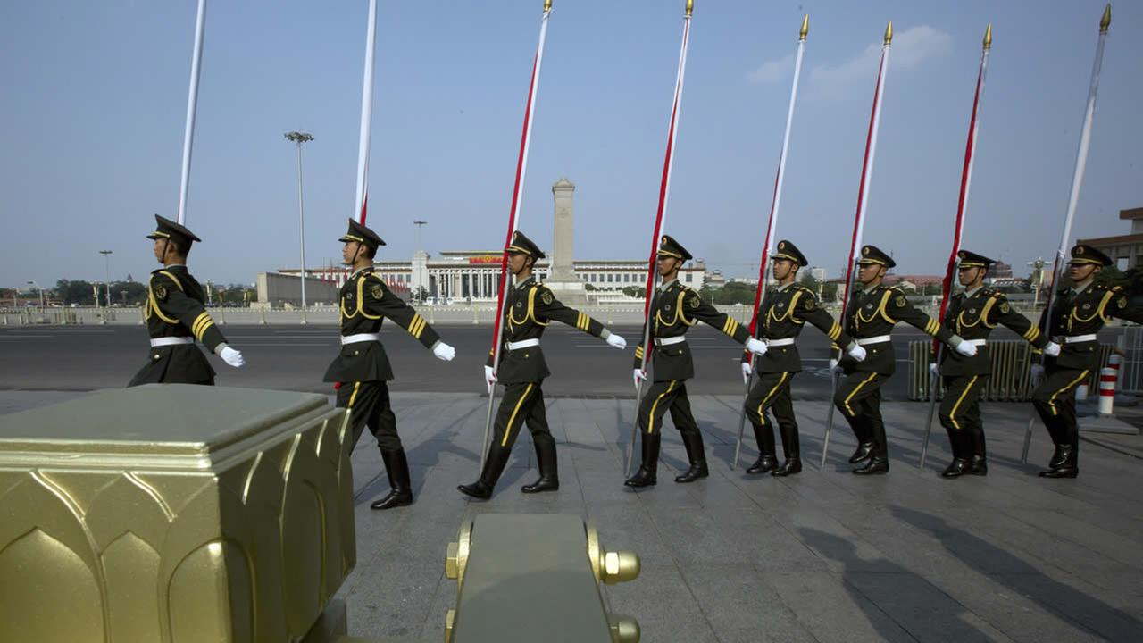 Peoples Liberation Army (PLA) soldiers march before an honor guard performance for a welcome ceremony near Tiananmen Square in Beijing, June 3, 2014. (AP Photo/Ng Han Guan)