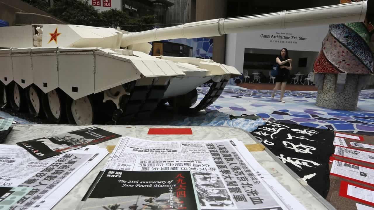 A mock tank is displayed to symbolize the man blocking a line of tanks at the 1989 pro-democracy movement in Beijing in Hong Kong, Tuesday, June 3, 2014. (AP Photo/Vincent Yu)