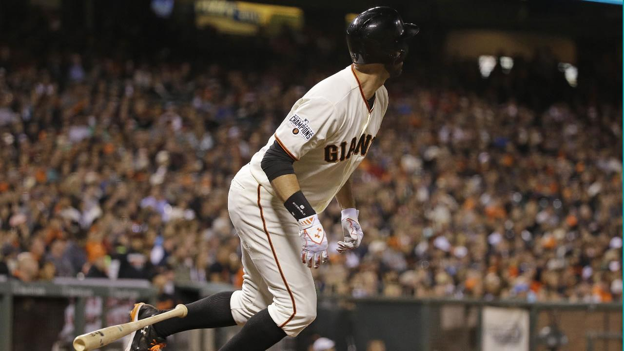 San Francisco Giants Brandon Belt hits a home run off Houston Astros starting pitcher Scott Kazmir in the sixth inning of their baseball game, Tuesday, Aug. 11, 2015.