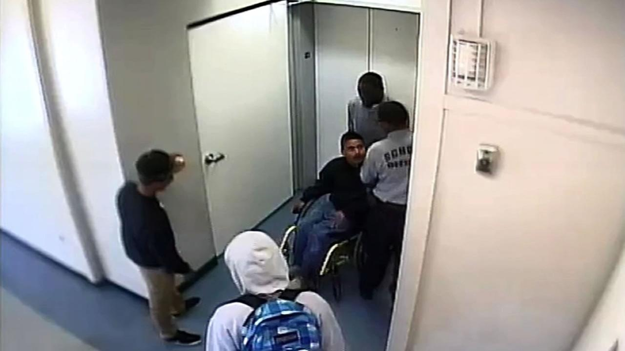 surveillance video at Oakland High School shows violent confrontation between a security guard and a student