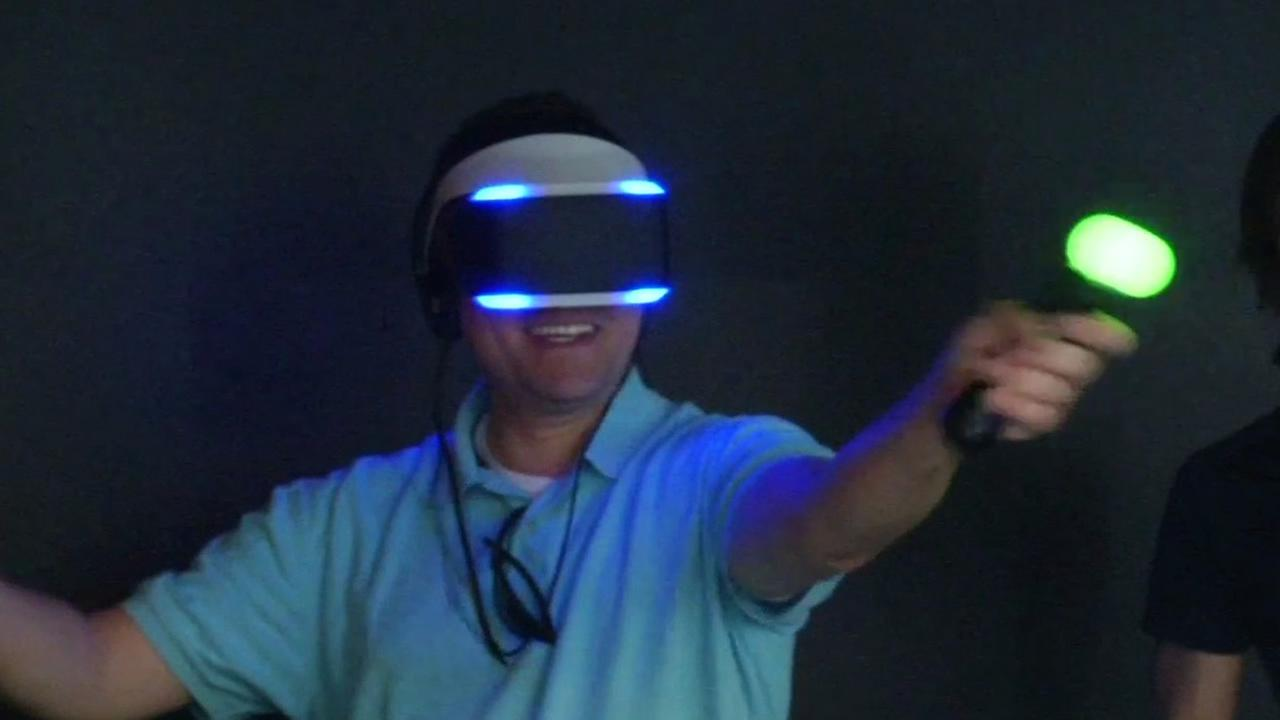 Person tries out virtual reality headset at Game Developers Conference in San Francisco