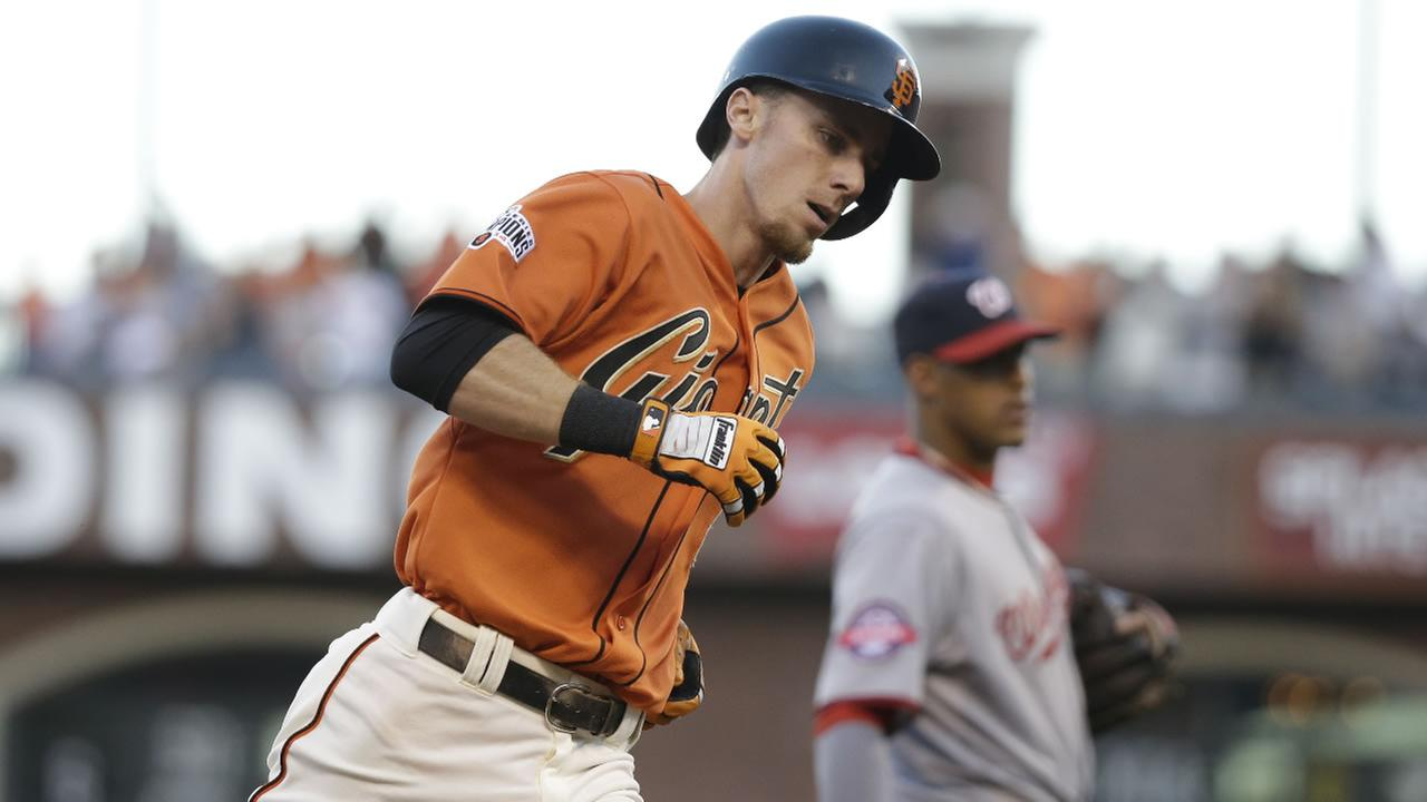San Francisco Giants Matt Duffy circles the bases after hitting a home run off Washington Nationals starting pitcher Max Scherzer in the first inning Friday, Aug. 14, 2015.