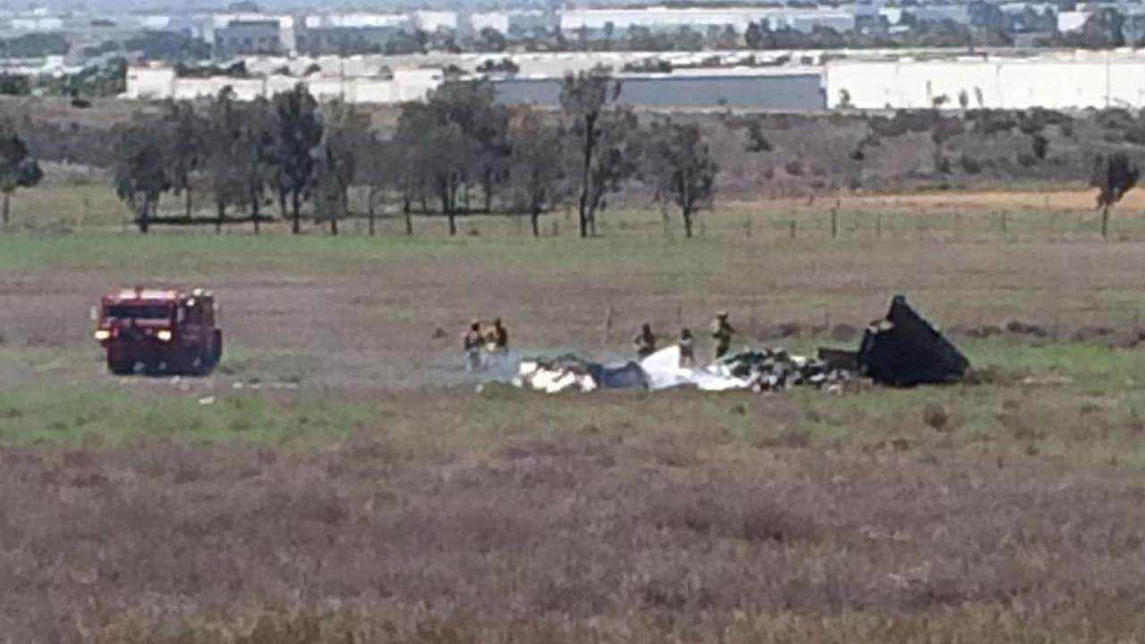 Emergency personnel are shown at the scene of a plane crash in San Diego County on Sunday, Aug. 16, 2015.