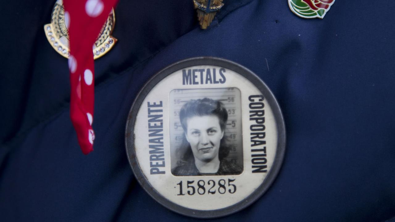 Rosie the Riveter Phyllis Gould, wears her identification button she used when she was working as a welder at Kaiser Shipyard in Richmond, Calif.