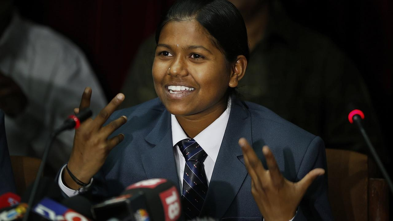 Malavath Poorna addresses a press conference in New Delhi, India, Wednesday, June 4, 2014. (AP Photo/Saurabh Das)