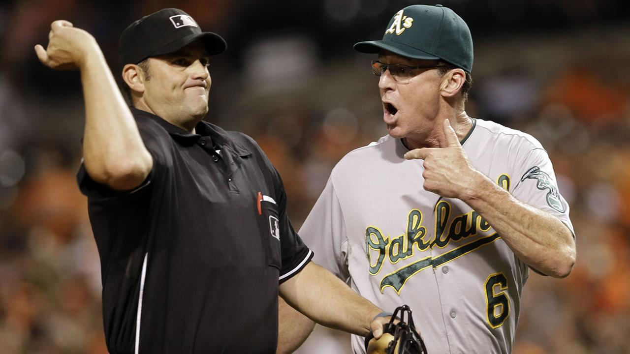 Athletics manager Bob Melvin, right, is ejected by home plate umpire Brian Knight during an argument during a baseball game against the Orioles, Aug. 17, 2015, in Baltimore. (AP Photo/Patrick Semansky)