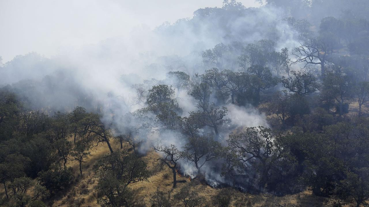 Smoke rises from fires burning on a hill in Livermore, Calif., Thursday, Aug. 20, 2015.