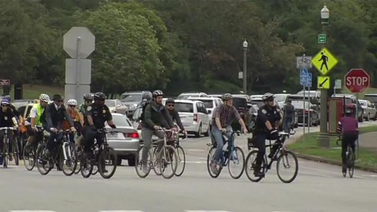 San Francisco police officers rode alongside cyclists near Golden Gate Park in San Francisco in a community-building bike ride August 20, 2015.